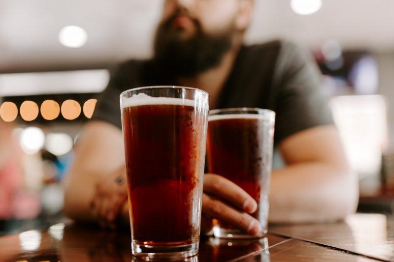 Two people enjoying craft beers on Anna Maria Island
