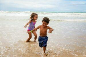 kids-running-on-beach