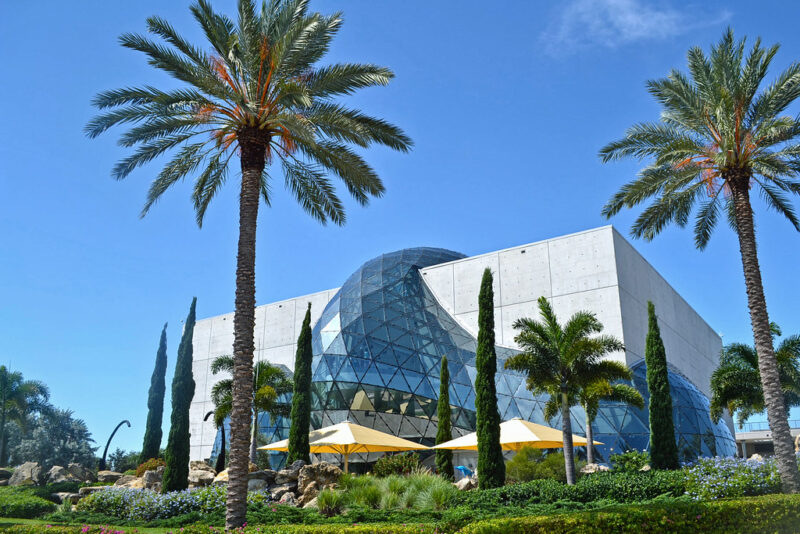dali museum from the outside surrounding by palms