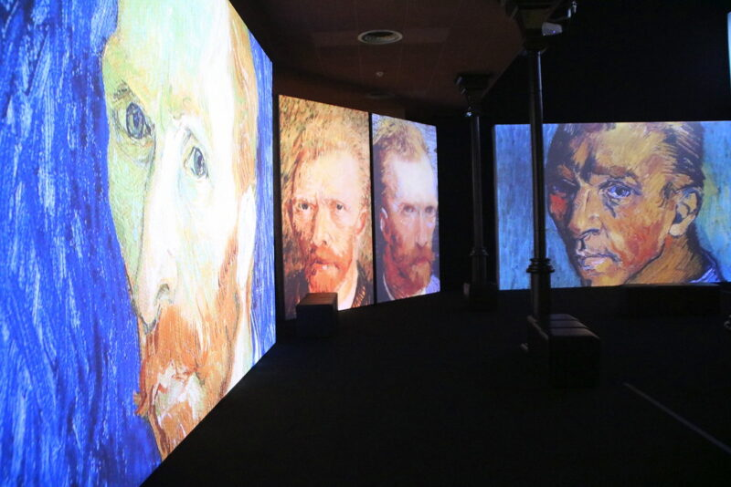 van gogh alive exhibit with pictures on wall