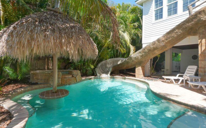backyard with pool and slide in anna maria island