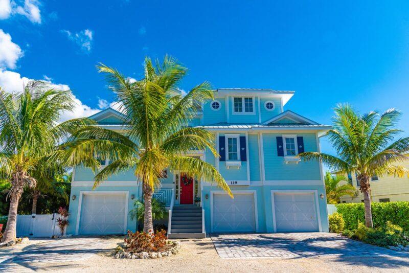outside of beautiful blue home in anna maria island